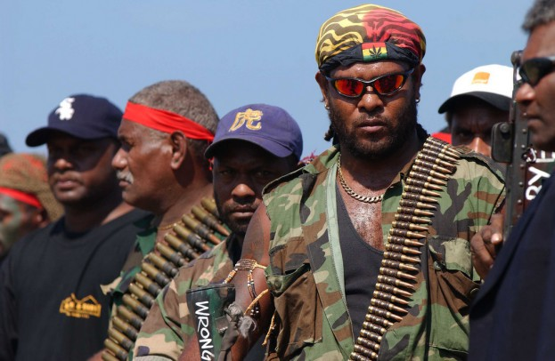 Former Malaitan eagle Force (MEF) militant, Jimmy Rasta and other members of MEF at Auki weapons surrender. Solomon Islands 2003. Photo: Gary Ramage, Australian Fefence